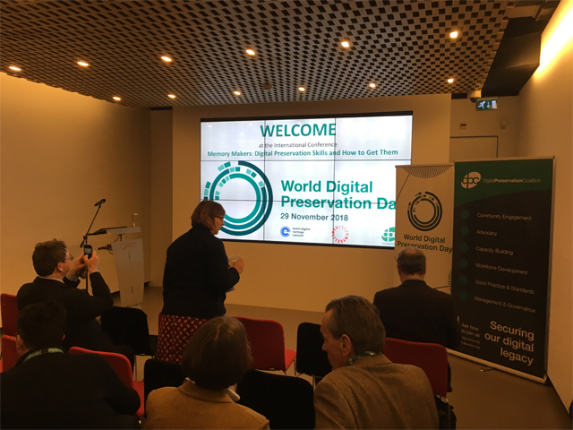 At the front in a room with people at the Digital Preservation Award event 2018