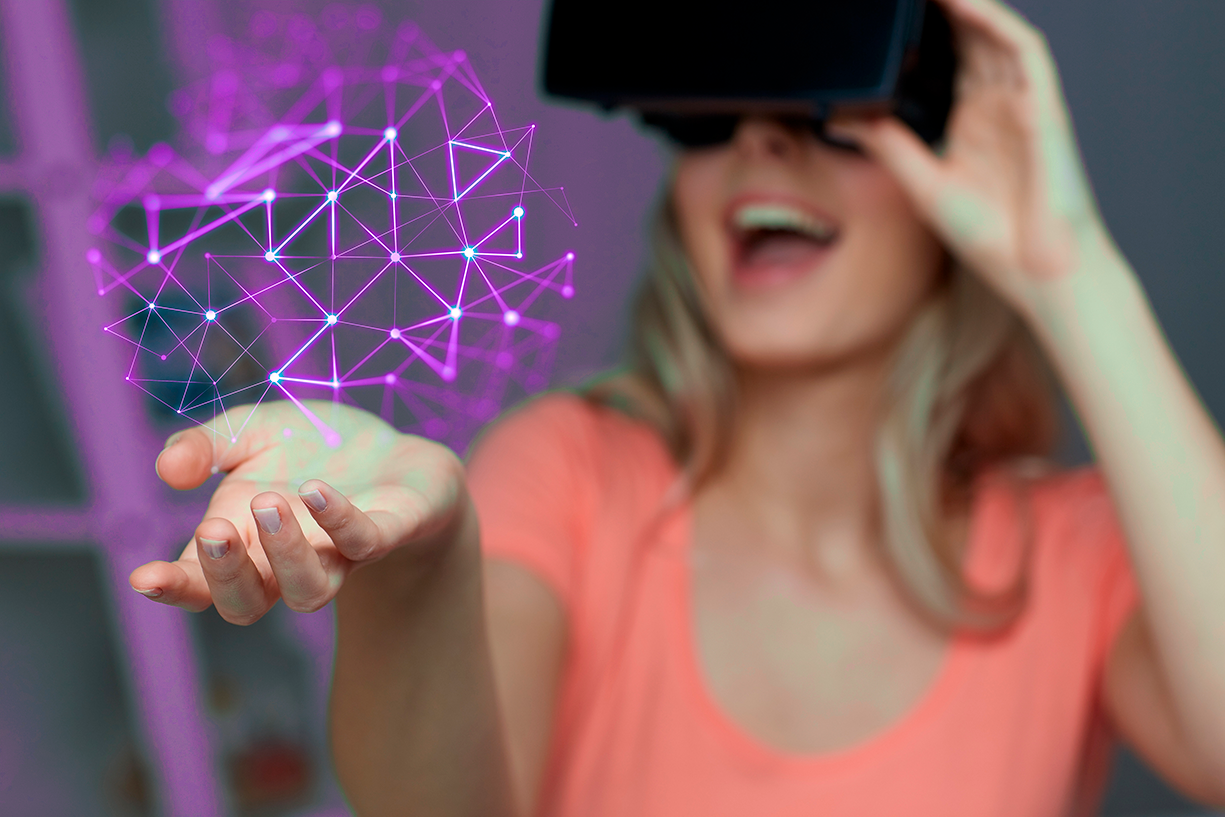 Happy woman with VR-glasses looking to hold a purple framework of a construction in one hand