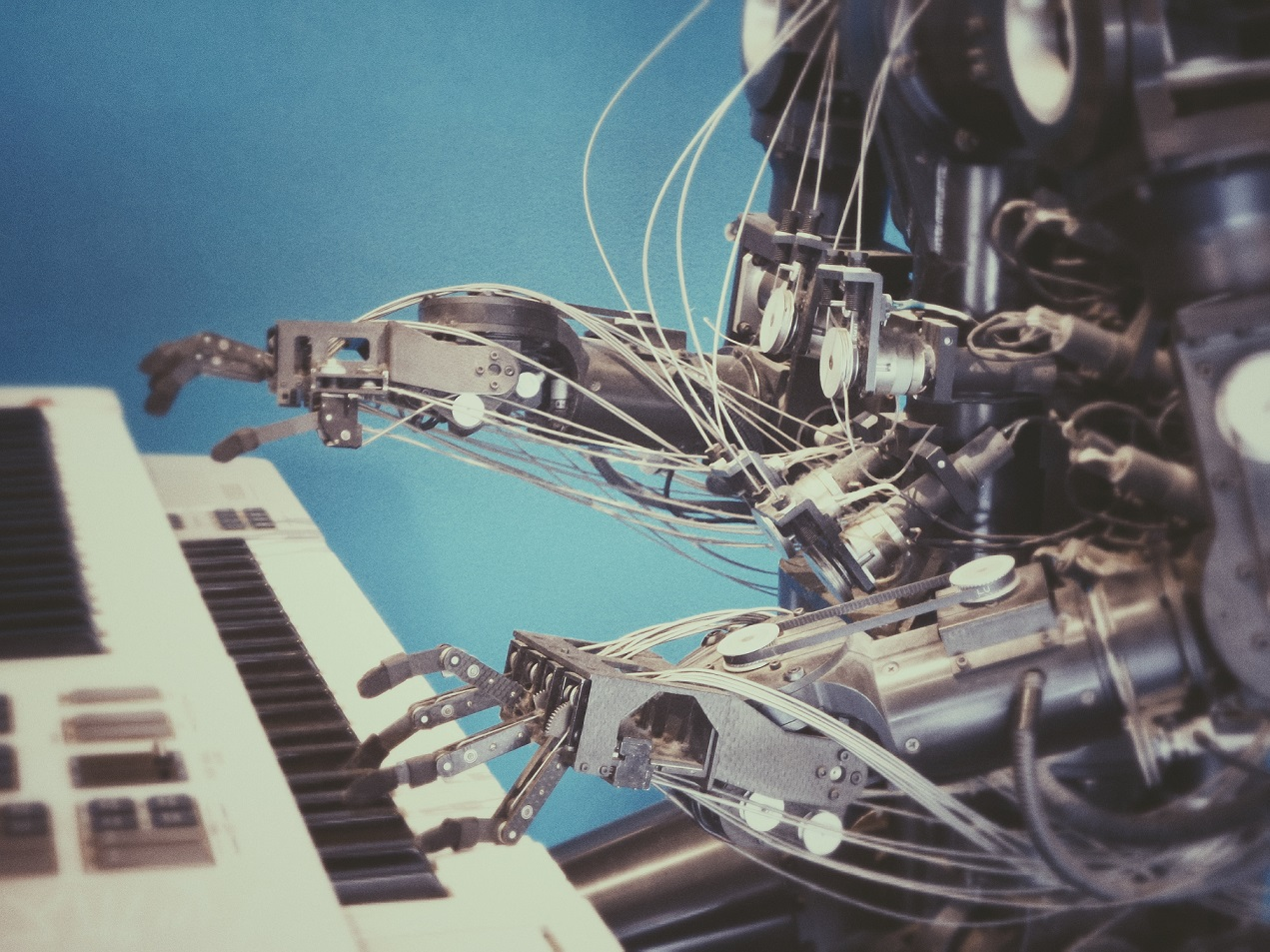 A robot playing the piano.