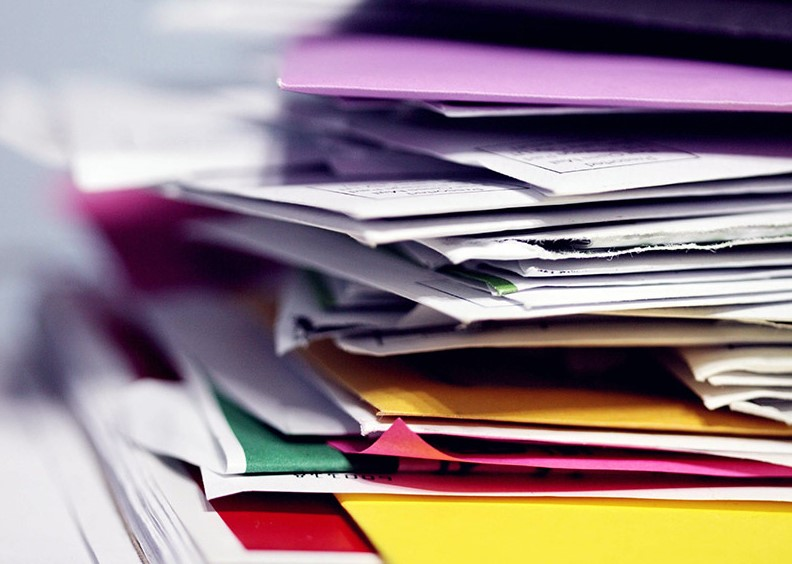 Pile of documents and colorful folders
