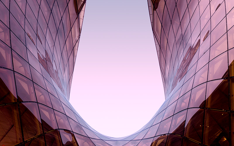 Glass facade in pink light